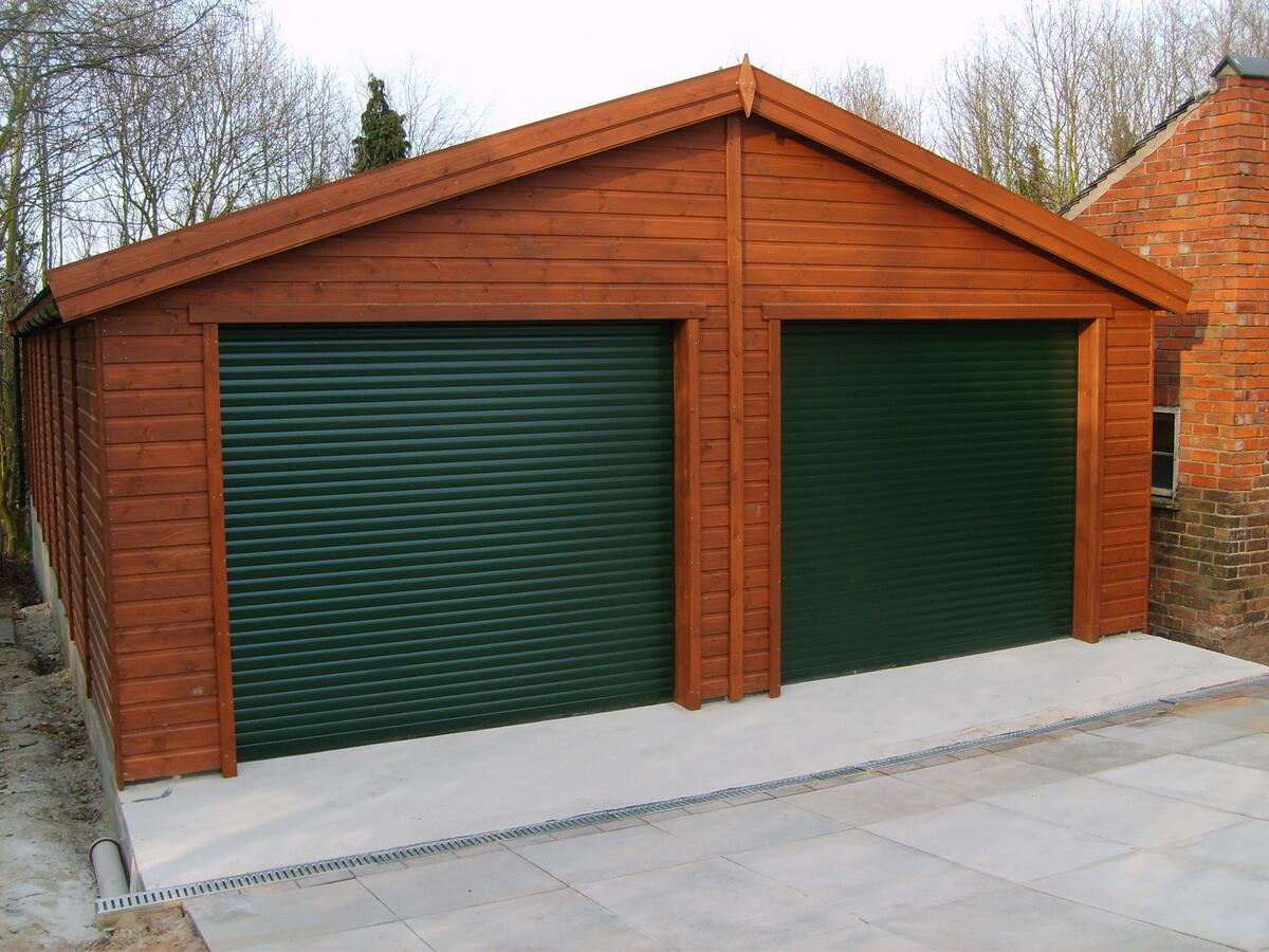 Brown Wooden Cladding ~ Wooden double garage with roller door