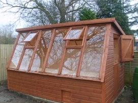 Solar potting shed with optional opening windows on front and stable door